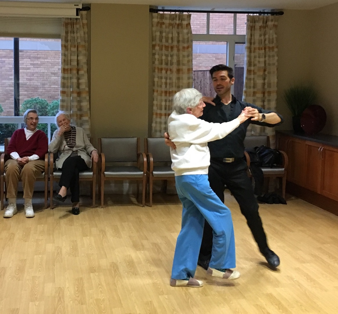 "Dance instructor J Michael Winward and Youville resident Anna Pier partner up for a foxtrot during ""Steps in Time,"" the bimonthly ballroom dance class held at Youville House Assisted Living Residence."