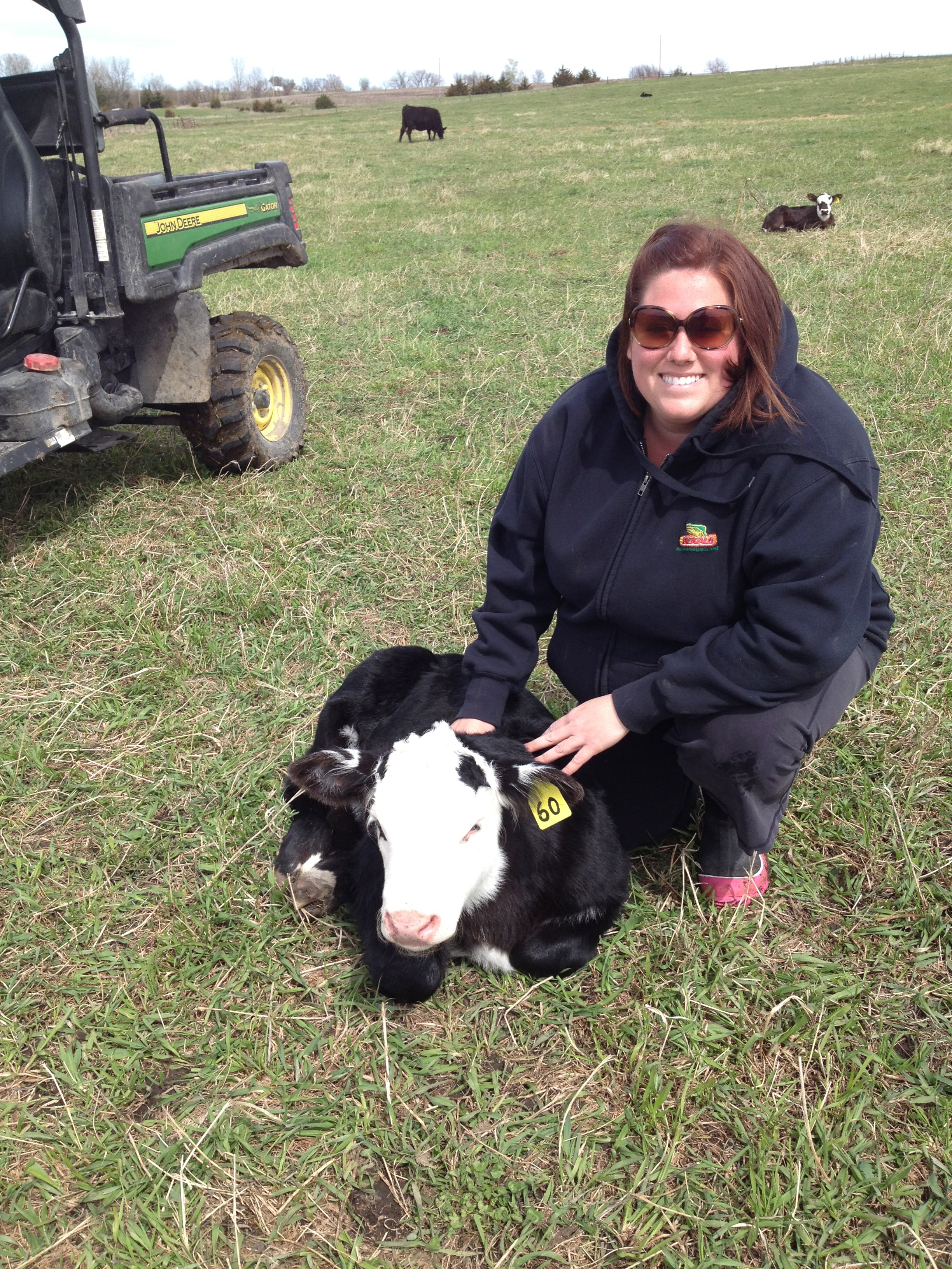 Jentry Graham checking out the new baldie calf for Hereford HQ