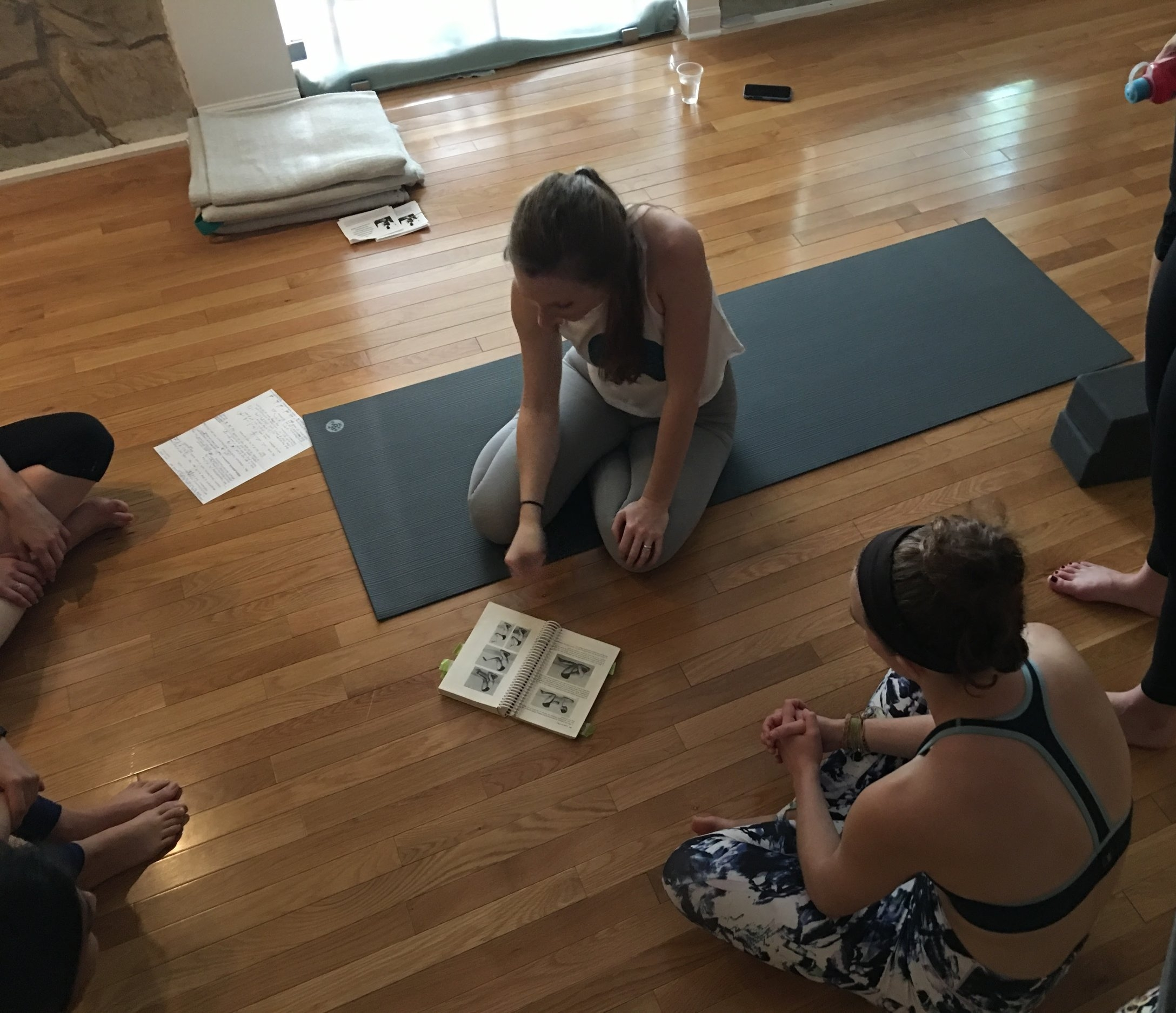 Students study from Light On Yoga with Laura