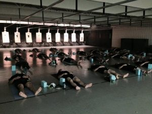 Recruits from the Des Moines Police Academy practice yoga as part of their academy curriculum.
