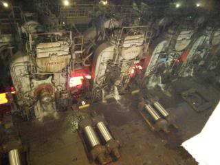 """Looking down at the 6 stand finish mill from the crane I operated."" [Photo file name: Reducing Gage Finish Mills - Ed.]"