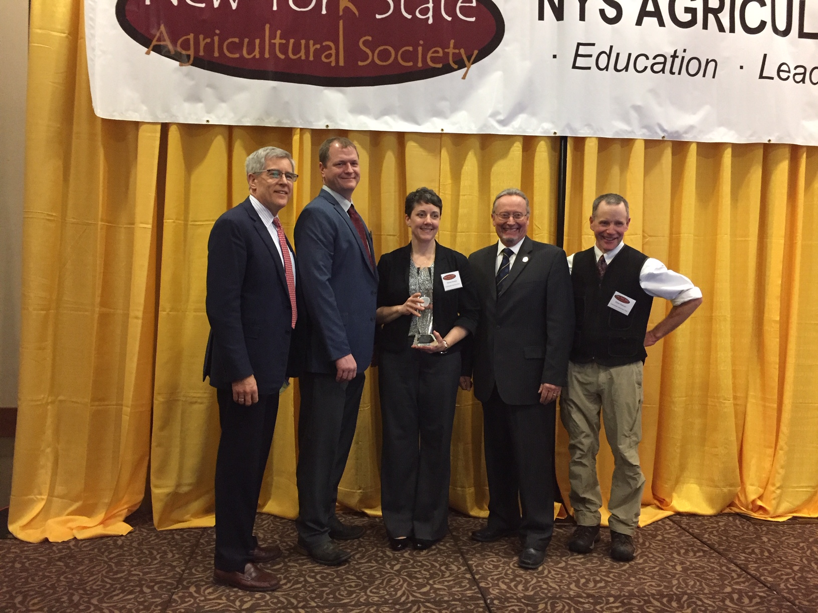 Rick Zimmerman and Commissioner Richard Ball present the Business of the Year Award to Countryside Vet Clinic principals Dr. Craig Pauly, Dr. Stacy Kenyon, Dr. Peter Ostrum.