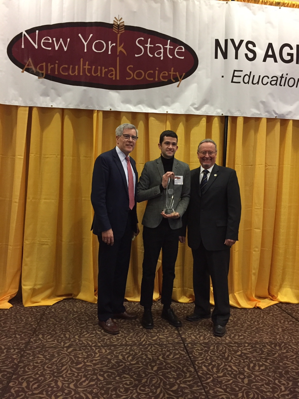 Brooklyn Grange Farm Manager, Seth Johnson, receives the Business of the Year Award from NEAFA Executive Director Rick Zimmerman and NYS Agriculture and Markets Commissioner Richard Ball.