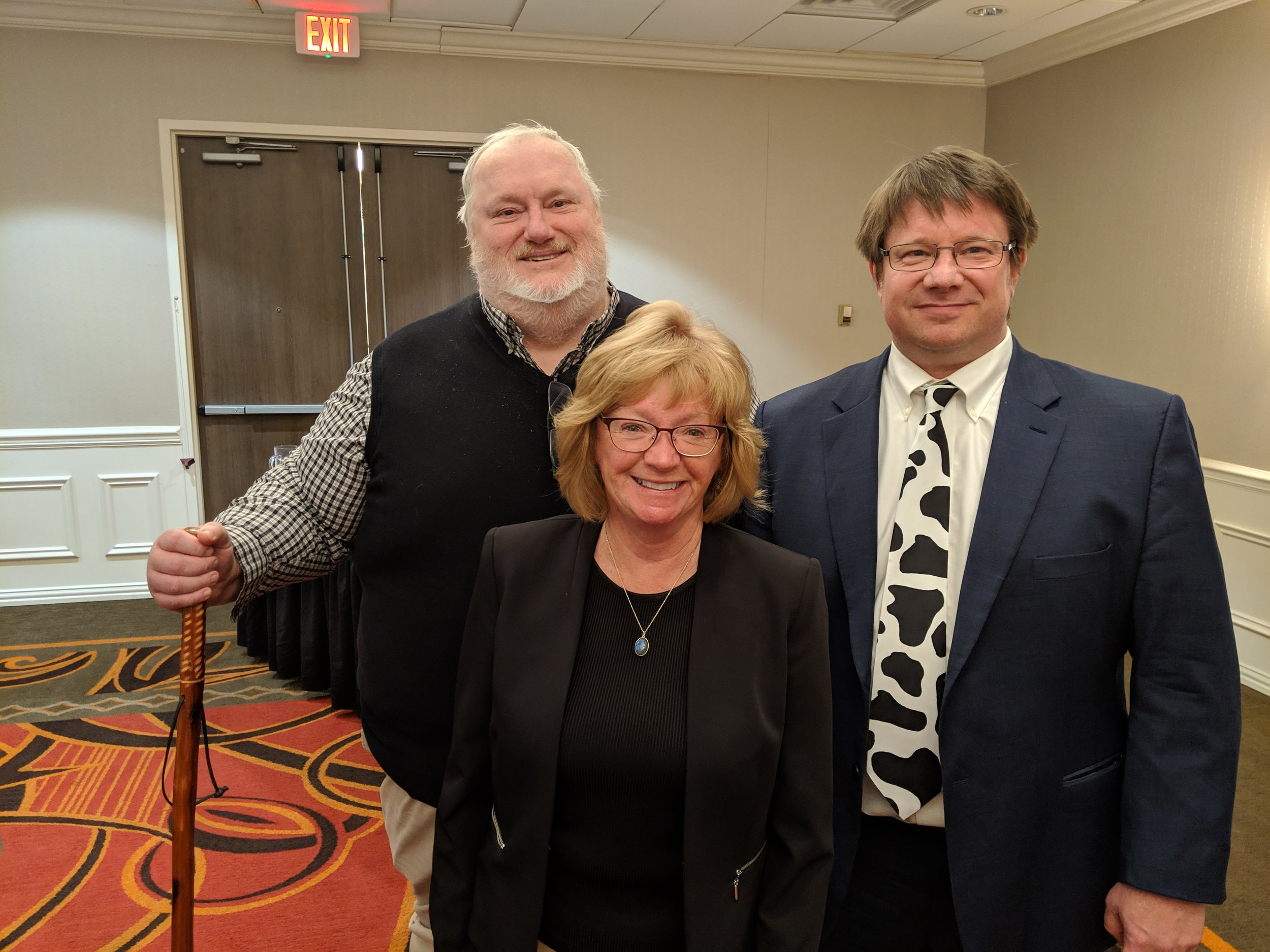 Agri Mark's Bob Wellington (L) and Farm Credit East's Chris Laughton (R) join UConn's Dairy Science professor Sheila Andrew at the March 21st Dairy Nutrition Conference in Windsor Locks CT.