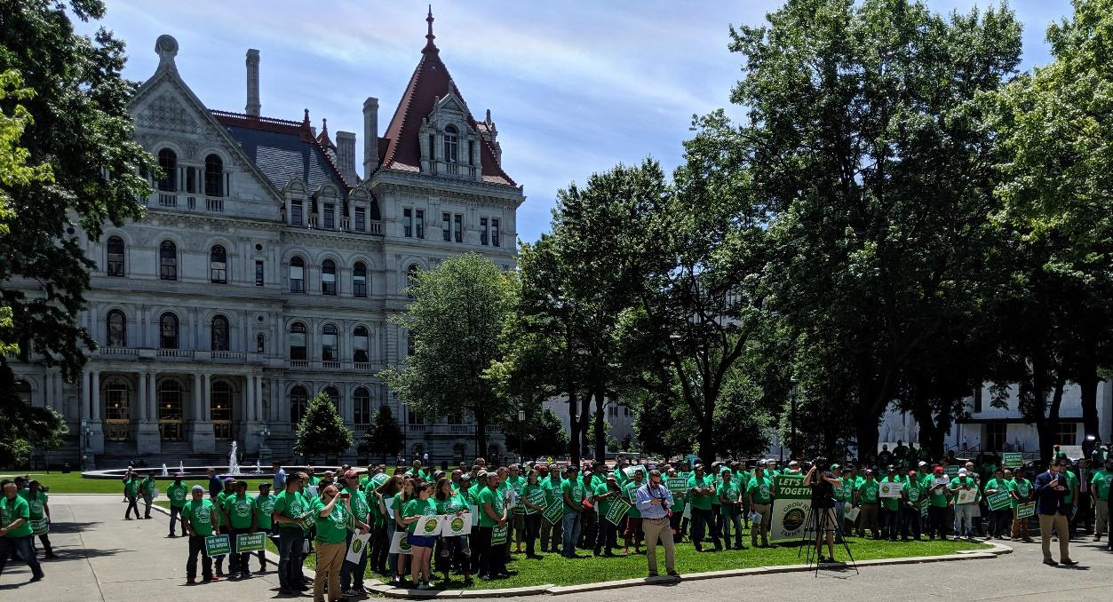 Over 300 farmers and farm workers gathered in front of the NYS Capitol to rally on the farmworker bill.