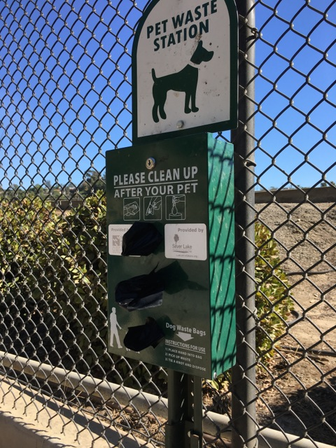 "Doggy Bag dispensers on the path help keep the path clean and free of ""obstacles"" along the way."