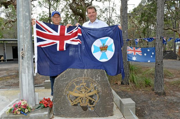 Brian Simpson (Simmo) being present with a Queensland State Flag by Member for Burnett Stephen Bennett MP