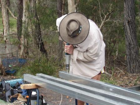 Rhino preparing the uprights.JPG