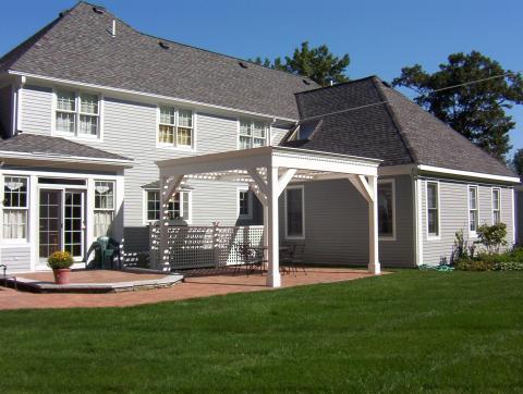 Custom weather-proof pergola and brick patio