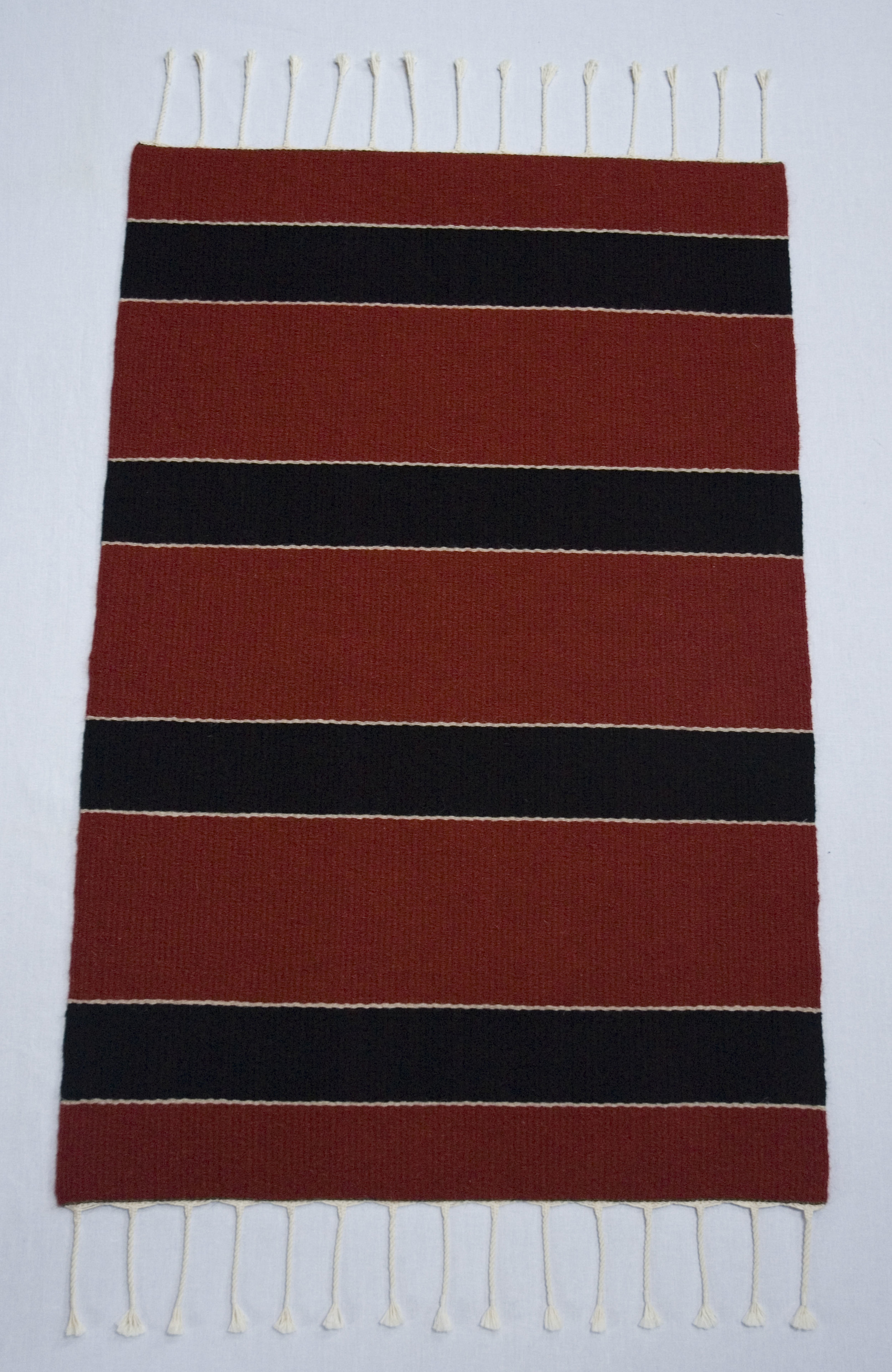 Plain weave rug with red and black stripes
