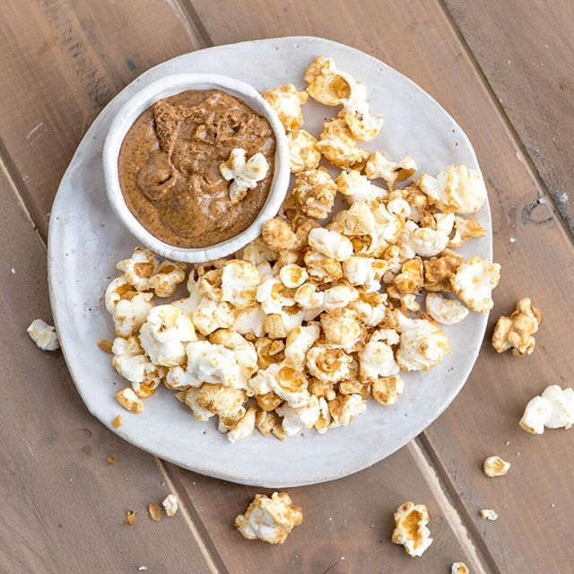 Himalayan salt, coconut nectar and maca popcorn, dipped in almond butter - absolute new obsession! #popcorn #newobsession #sweetandsaltypopcorn #popcorn #healthypopcorn #ninaspopcorn #amondbutter