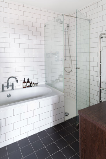 Old School House, East London - Our most popular image on the Houzz web site! This apartment was a conversion in an old Victorian school. The client wanted a modern, uncluttered feel and to keep the finishes light and bright.