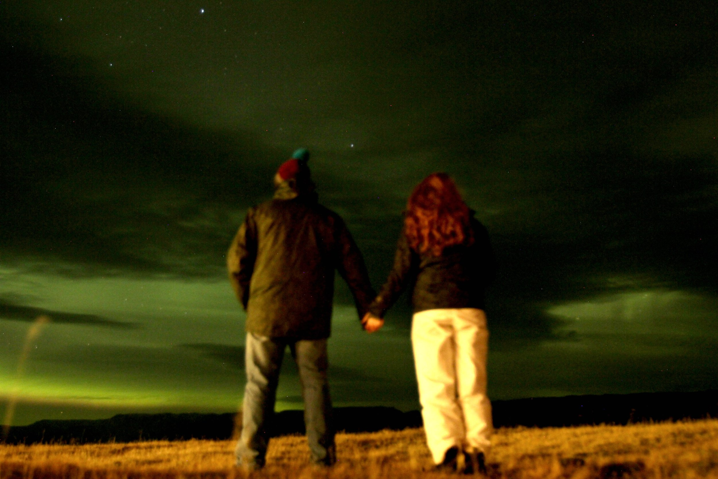 Northern Lights in Iceland - they looked grey to our naked eye, but turned out green with the camera...crazy!