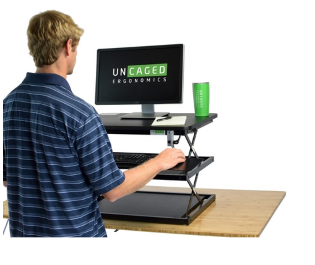 CHANGEDESK STANDING DESK CONVERTER - Uncaged Ergonomics has a great product for those who work on a computer, and need to be able to convert from sitting at a desk to standing. It is easily adjustable from 4.5