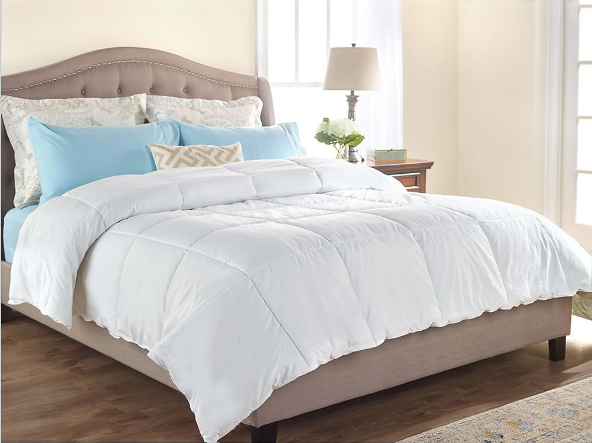 """The Temperature Regulating Comforter - Hammacher Schlemmer - We have officially found the coolest comforter ever. This comforter uses fabric developed for NASA! It was designed to """"help astronauts adapt to extreme temperature fluctuations, this comforter prevents overheating and eliminates chills to create an optimal sleeping climate."""" That means that this comforter can help you stay at the perfect temperature while you're sleeping. No more sleeping too hot or too cold. It is 300-thread count and made from 100% cotton on the outside, and inside it has 50% outlast/50% polyester fiberfill. And you can wash and dry it in the machine! The other awesome thing about this comforter is that it allows 2 sleepers, who have 2 different temperature preferences, to stay to their ideal temperature while sleeping. The comforter has microcapsules that take up your extra heat when you're too hot, and will release the extra heat when you get cold. It comes in Twin, Full, Queen, and King size as well. You'll be sleeping cooler…or warmer, in no time! Check out this awesome comforter below!"""