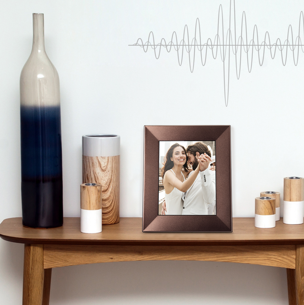 Nixplay Wifi Picture Frame - We have found the coolest present for your mom, dad or grandparents! Or maybe sibling away at school...Aunts and uncles across the country...ok, this gift could really be for anybody on your list. It's a Wifi Digital Frame from Nixplay. Remember those frames that switch photos every few seconds and it was like a whole photo library in that single frame? Well, this one is so much better! You can upload new photos from your house straight to their frame! Snapped some awesome pictures of your sons t-ball game, and want to share with your mom? Just go to the app, and add the photos to her frame, and they will show up! How cool is that?! There can always be fresh pictures, and it will help keep your loved ones right there along for whatever you're doing. The Nixplay Iris 8 comes in 3 beautiful colors, and it can be landscape or portrait and the photos will automatically adjust. These frames will dim and brighten depending on what the lighting is in the room, and will also start up when it detects sound in the room.Give your mom all the bragging rights this holiday season, and grab one of Nixplay's awesome Wifi frames!