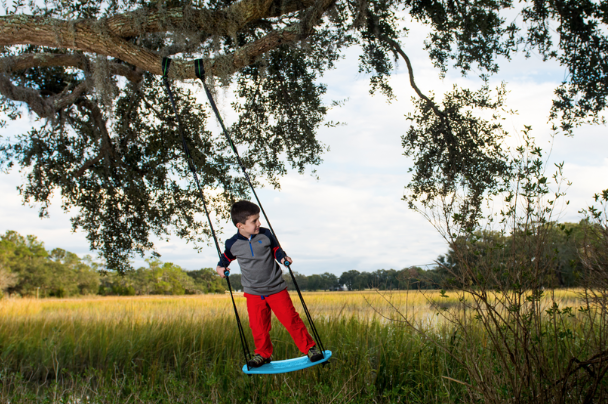"""FlyBar Swurfer Kick and pogo Sticks - Flybar is a great company that has a line of fun childrens activity equipment like skateboards, trampolines, pogo sticks, and so much more. One of our favorites was this Swurfer Kick Stand Up Tree Swing. It's a tree swing that you can actually stand on and """"surf"""" the air. It's made of durable plastic and can hold up to 150 pounds. Its easy to set up in your tree and comes with """"20 feet of double braided, UV and mildew resistant rope, and set of handles."""" You can also get it in 3 different colors. This Swurfer Kick is sure to bring lots of outdoor fun to your kids.We of course also had to order a Pogo Stick. Flybar has so many different types of pogo sticks, from automatic ones that will count your hops, to foam ones for your smaller children. Flybar has a pogo stick for everyone in the family! Check them out below!"""