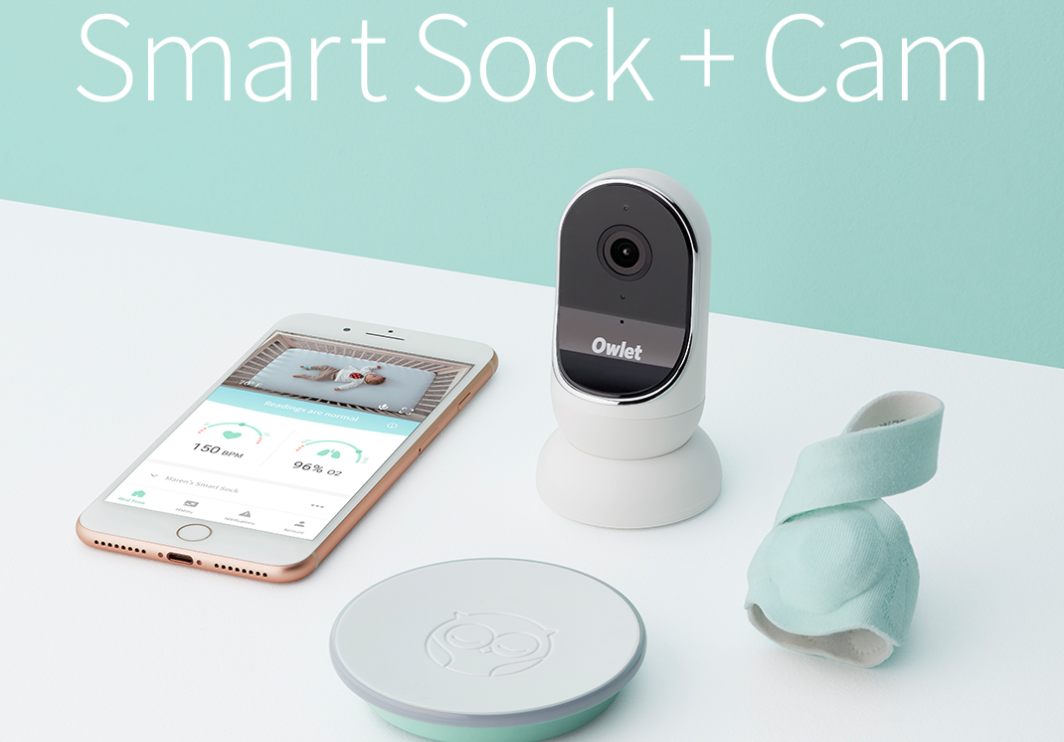 """Owlet Smart Sock and Cam for Babies - If you have a pregnant or new mom on your list, we found a gift she will love so much. The Owlet Smart Sock and Cam. The Owlet Smart Sock is an awesome product that will track your baby's heart rate and oxygen levels whenever they are wearing the sock. The sock is super soft, and won't be uncomfortable for your baby at all. Owlet has come out with a new Smart Sock and Camera bundle, so you can get the baby cam as well. The Owlet cam gives you live streaming audio and video of your baby, and when connected to the smart sock, you can have your full baby monitoring right on the app so you can see your baby wherever you are. It also allows for """"active listening through the Cam's background audio allowing parents to listen to their baby while using their phone for other tasks."""" And you'll save money with the bundle. You can have complete baby monitoring with the sock and cam bundle at all times. Perfect for any new mom or dad wanting to keep track of their baby's well being as well as keeping a close eye on them as well. Check out all the details below."""