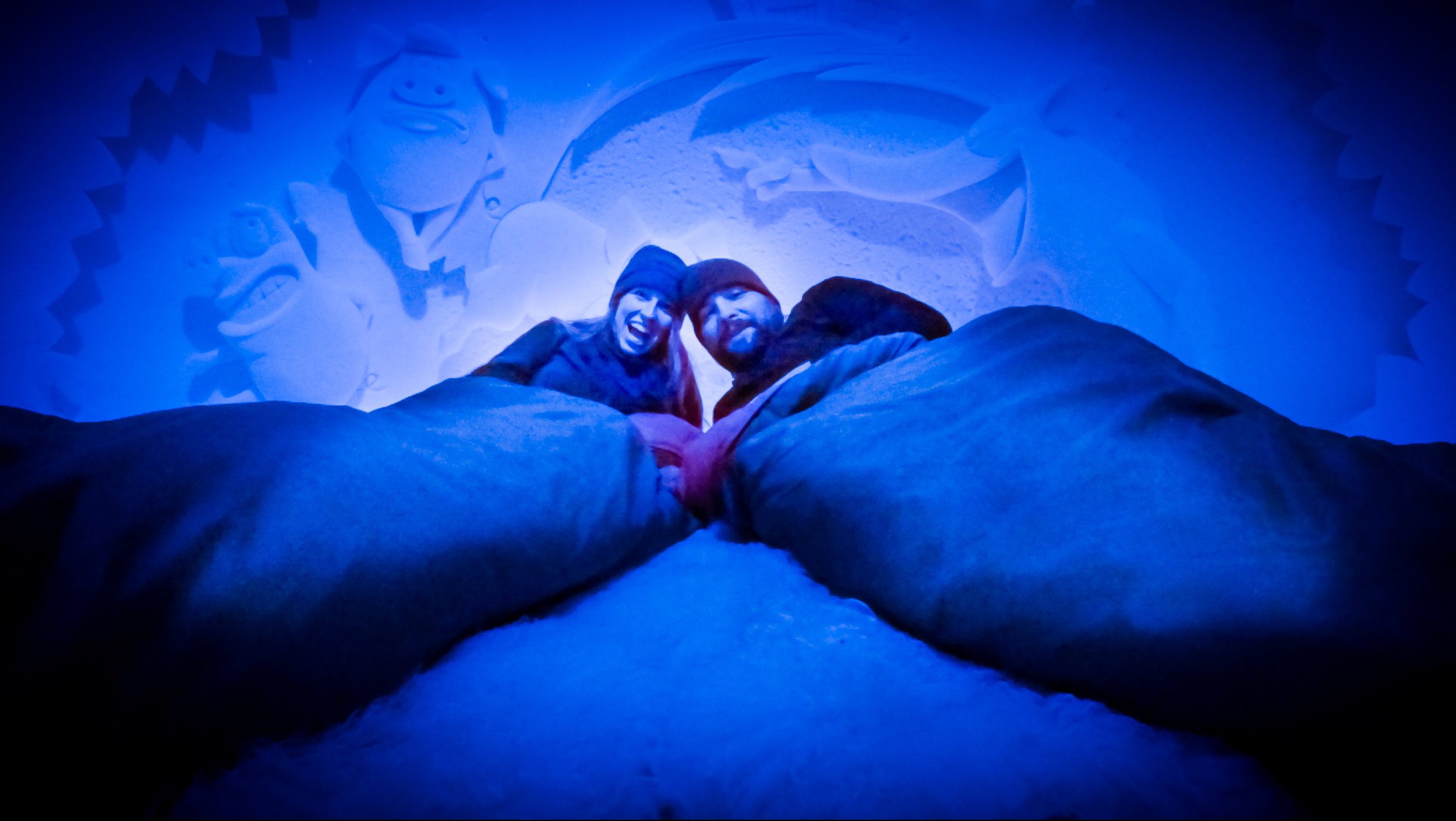 Couple Bundles In Sleeping Bags In A Snow Castle