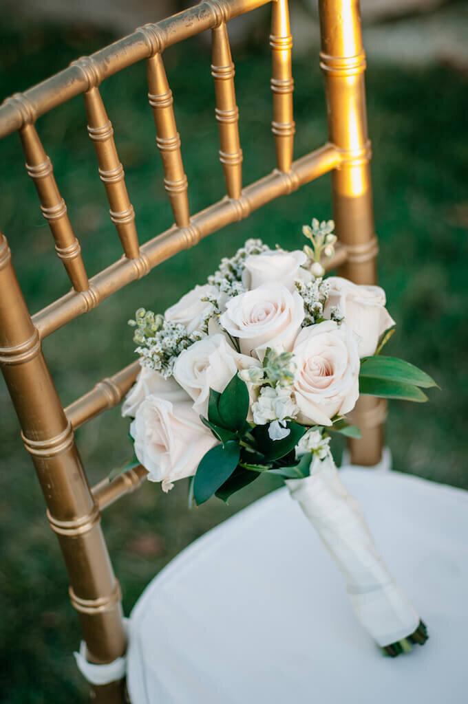 wedding bouquet sitting on a chair