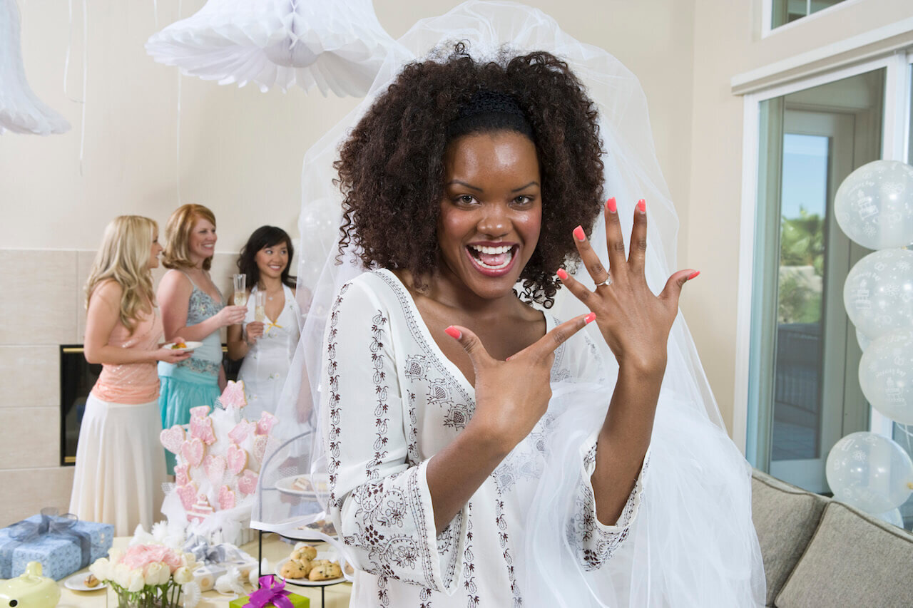 Bride to Be showing off her engagement ring at her bridal shower