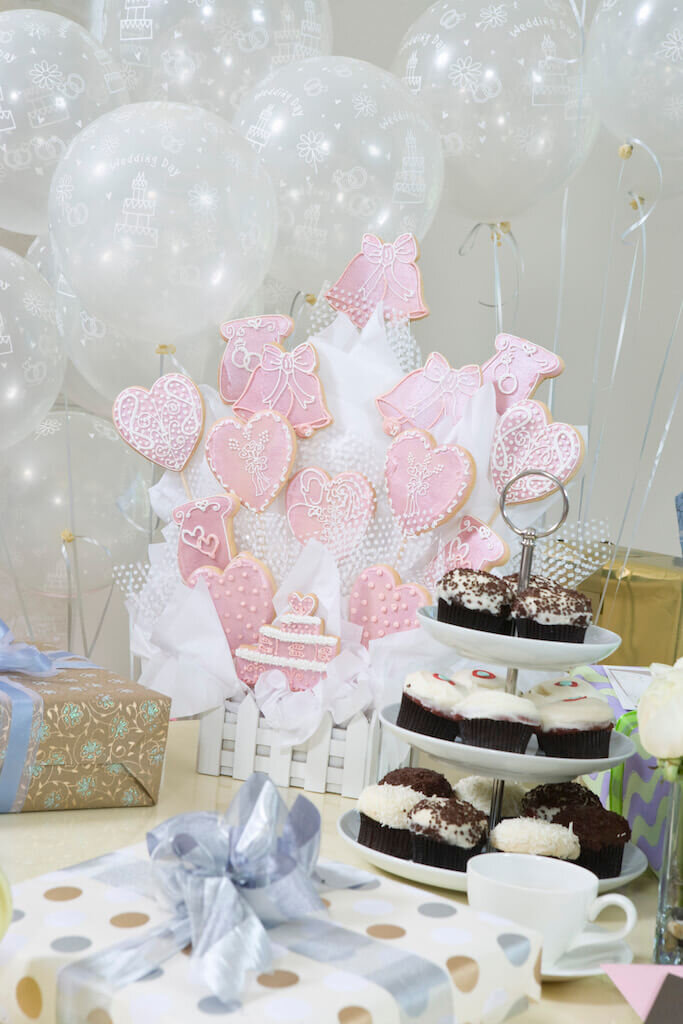 table full of sweets at a bridal shower theme love is sweet