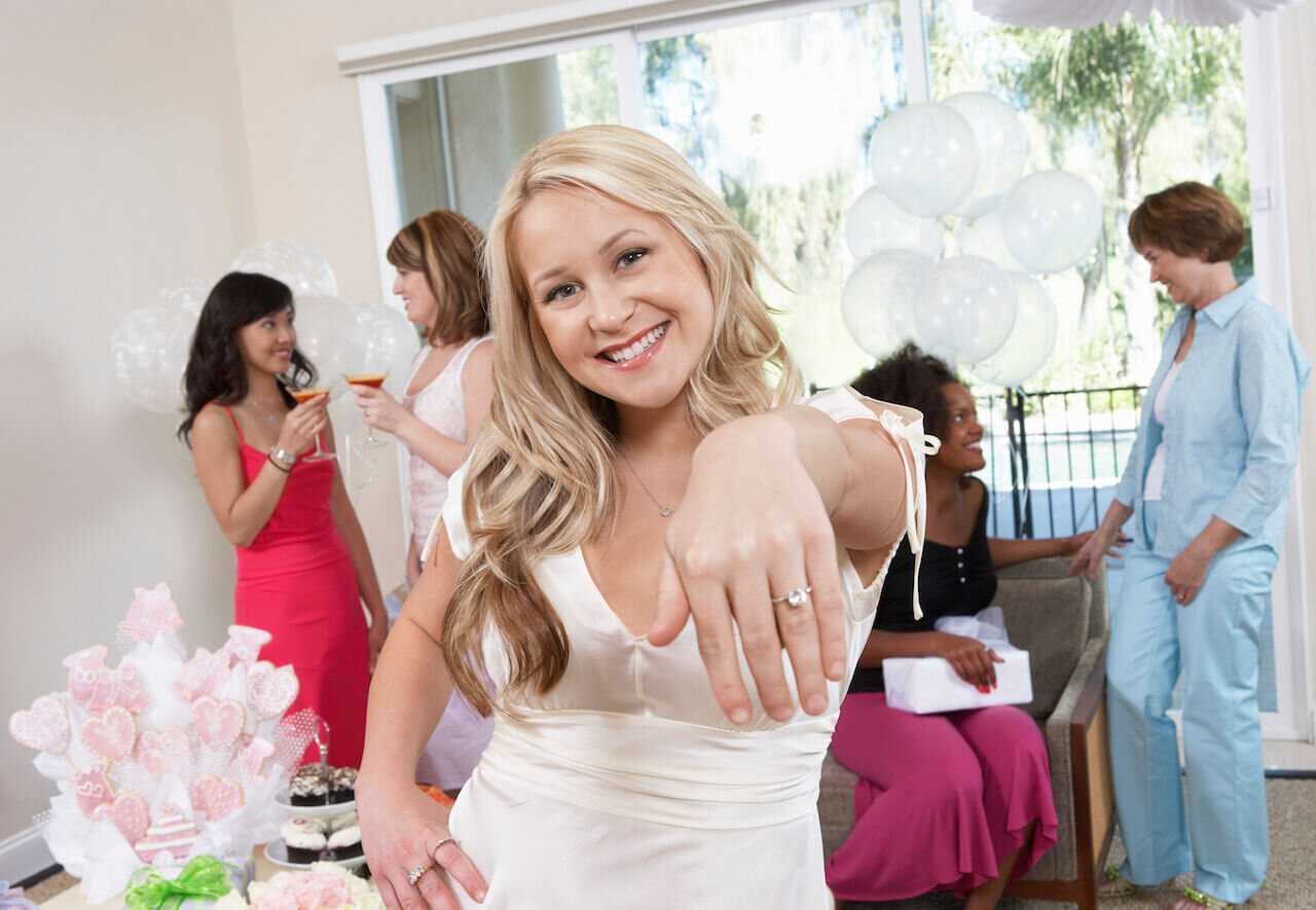 Bride showing off her ring at wedding shower