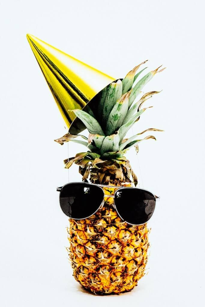 Pineapple wearing a party hat and glasses for a summer themed bridal shower