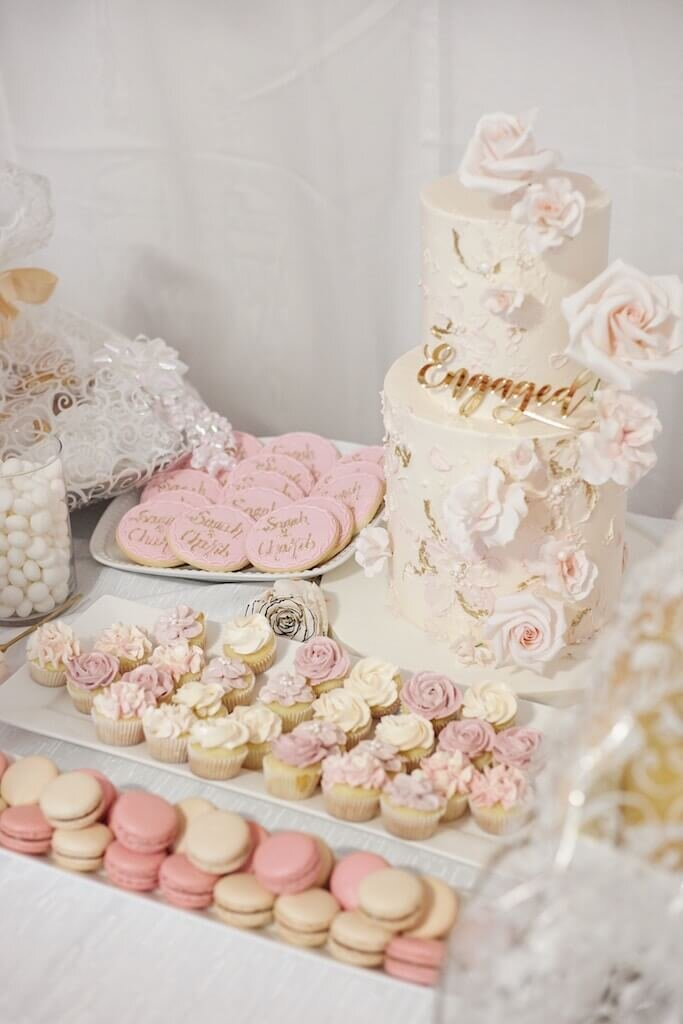 Table full of desserts at a sweet themed bridal shower