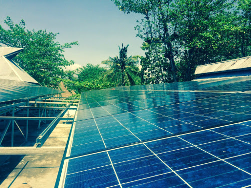 A solar photovoltaic (PV) system provides renewal energy & water heating