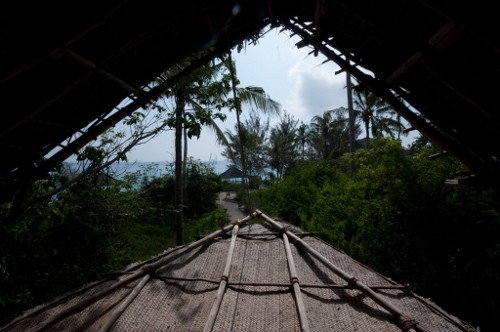 Lowering a banda roof section on chumbe island