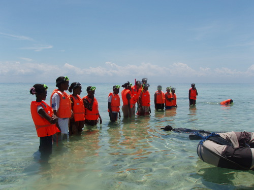 community girls learn to snorkel, about coral & conservation value at chumbe