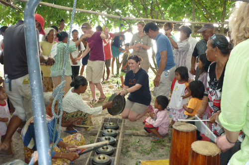 playing gongs with the locals in a borneo fishing village on the south china sea