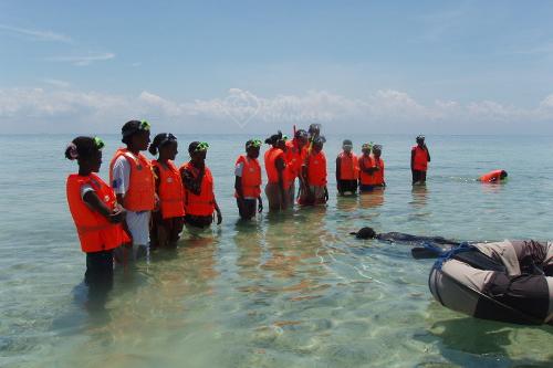 chumbe island coral park teaches girls marine conservation & to snorkel & swim
