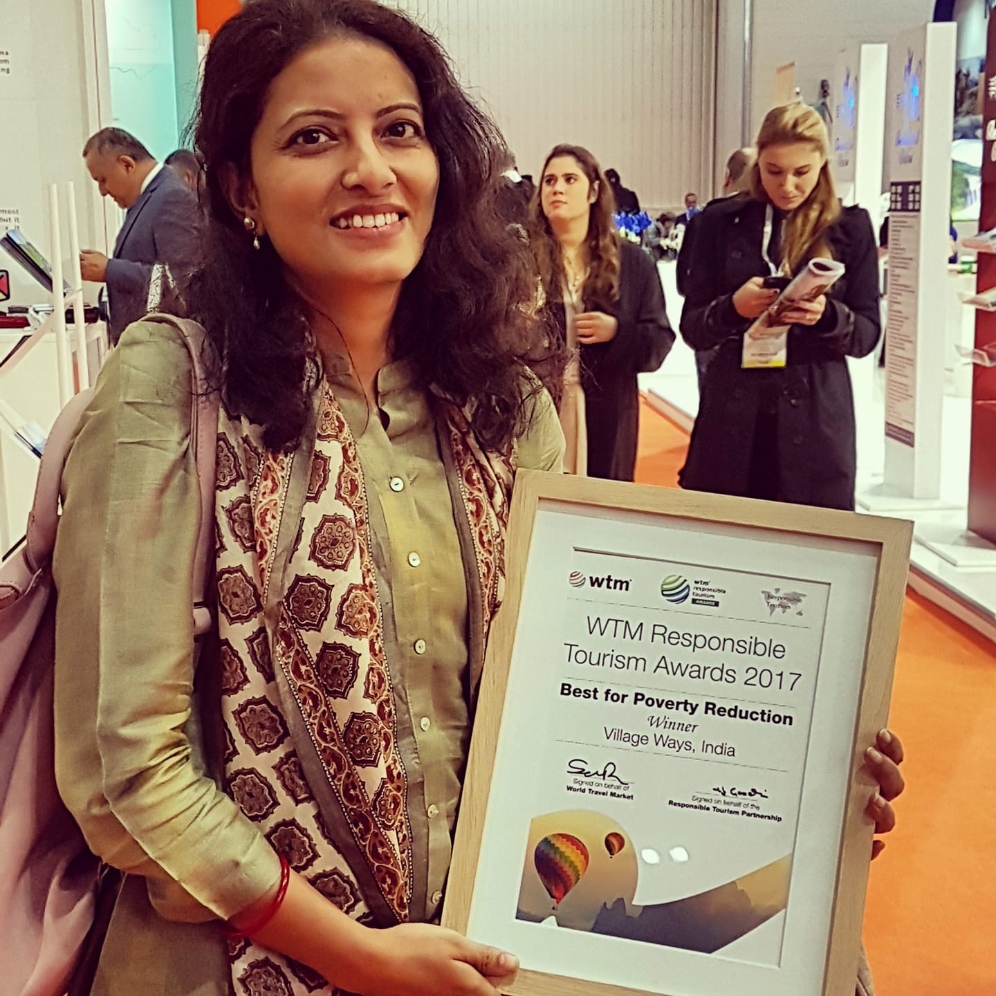 manisha accepting the world responsible tourism award for poverty reduction in 2017