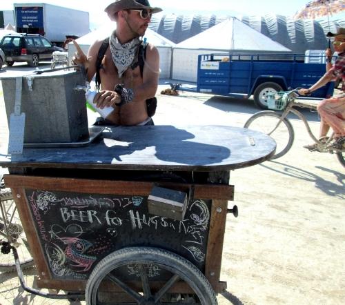 """""""Beer for Hugs & Kisses"""" Cart at Burning Man"""