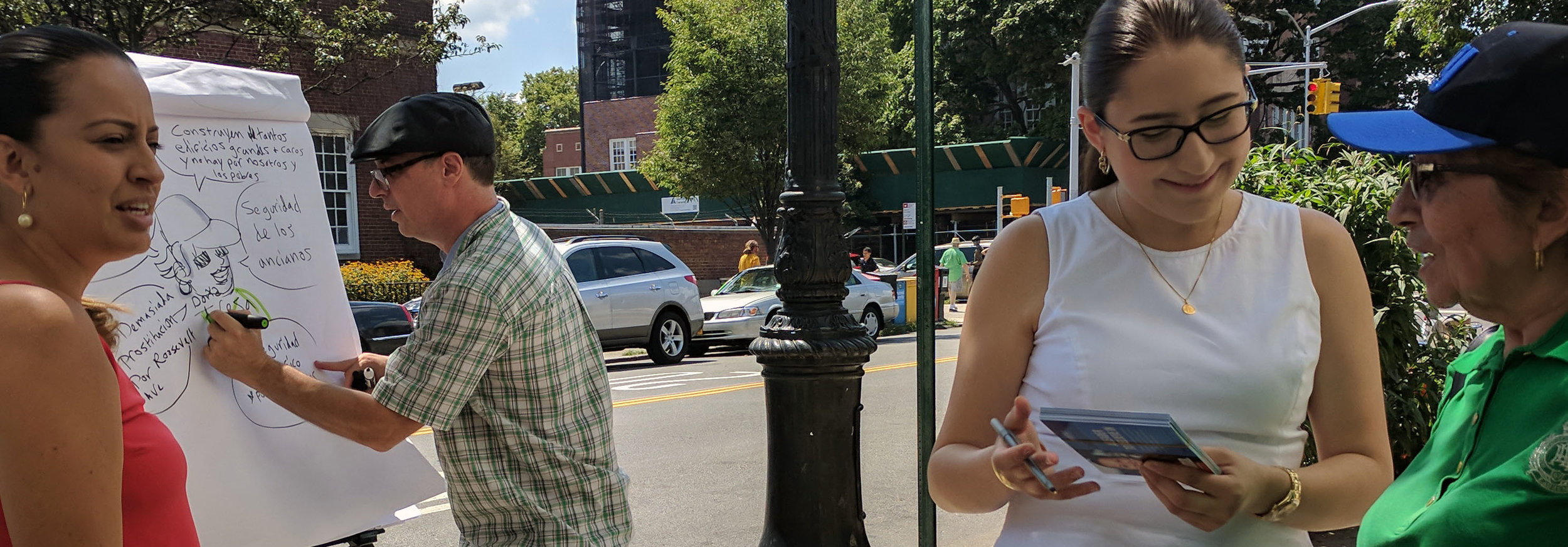 This is an action scene of candidate Catalina Cruz talking with voters on the sidewalk about issues that concerned them while I visually captured those concerns on a flip chart in words and pictures.