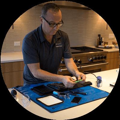 Smart Mobile Tech Repairing Phone In Home.png