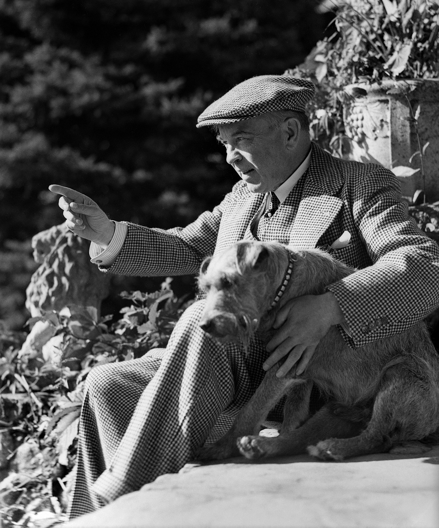 William Lyon Mackenzie King with his dog, Pat I, at Moorside Cottage.  August 21, 1940. Creator: Yousuf Karsh.  CC Attribution 2.0