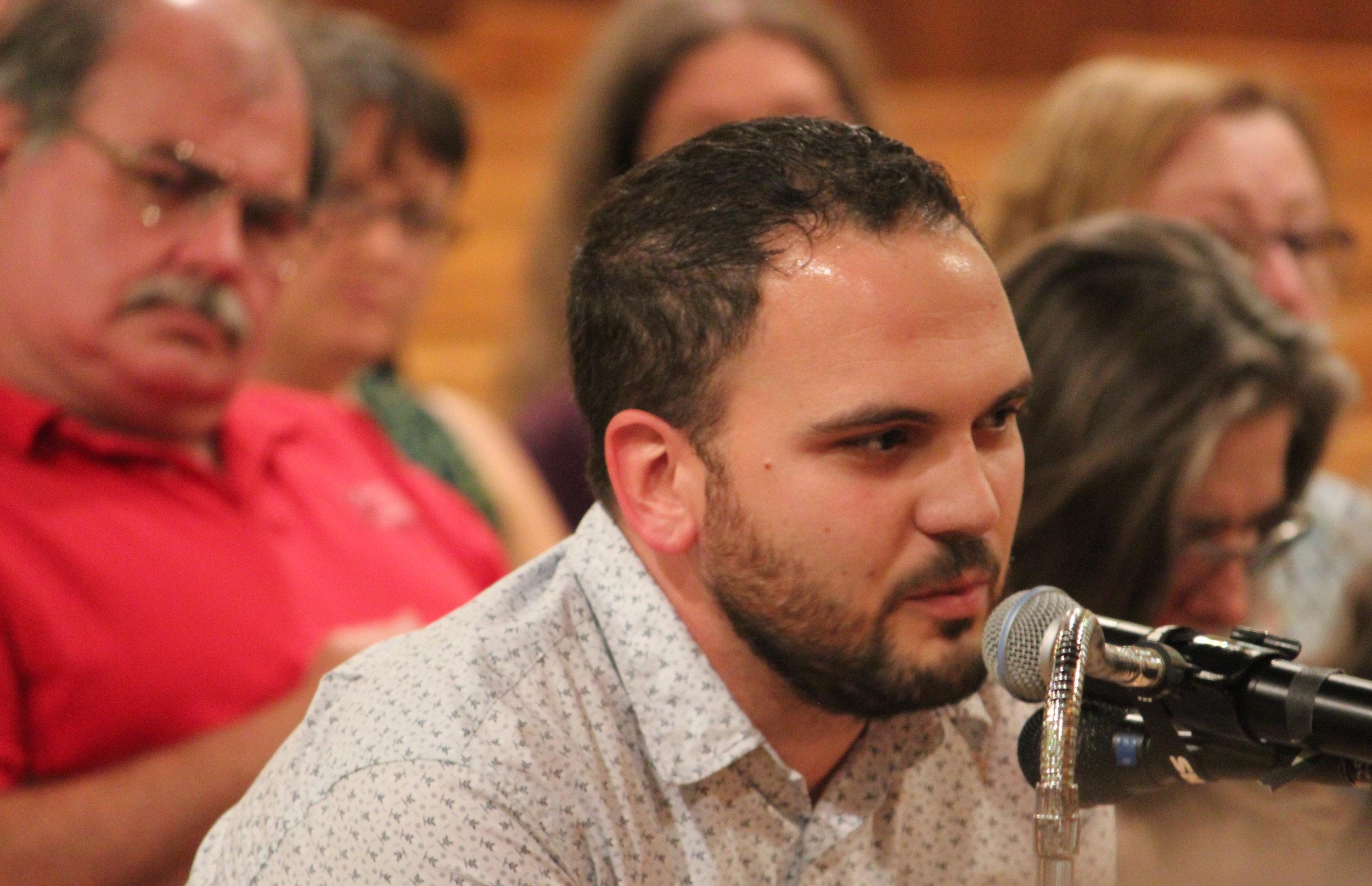 Scott Fernandez, of IUE-CWA Local 301, offers testimony.