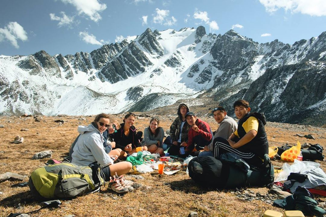 French-Kyrgyz Hikers Group Having Rest After Crossing the Pass