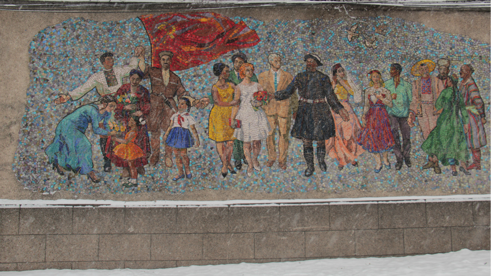 Alexei Mihalev's 'Reception of Guests' panel is called 'Peoples' Friendship' by Bishkek citizens. It is located on a special wall on Mira ave. next to Ormon Khan monument and the old airport.
