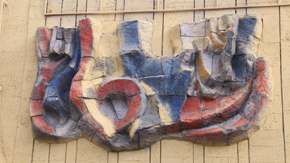 The bas-relief on the circus building need repair.