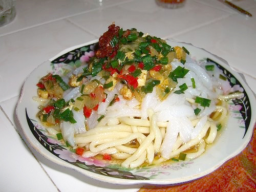 """Do you know that the landmark of the city is Ashlianfu,a dish of Dungan cuisine? The local recipe is famous in the entire Kyrgyz Republic so you should try it. Ingredients include noodles, gravy, garlic, vinegar and cornstarch. Ashlianfu is served cold, so it is great during a summer heat. And if you order a """"meat version"""", you'll be full for half a day, except repeating that in the evening — it's very filling and delicious."""