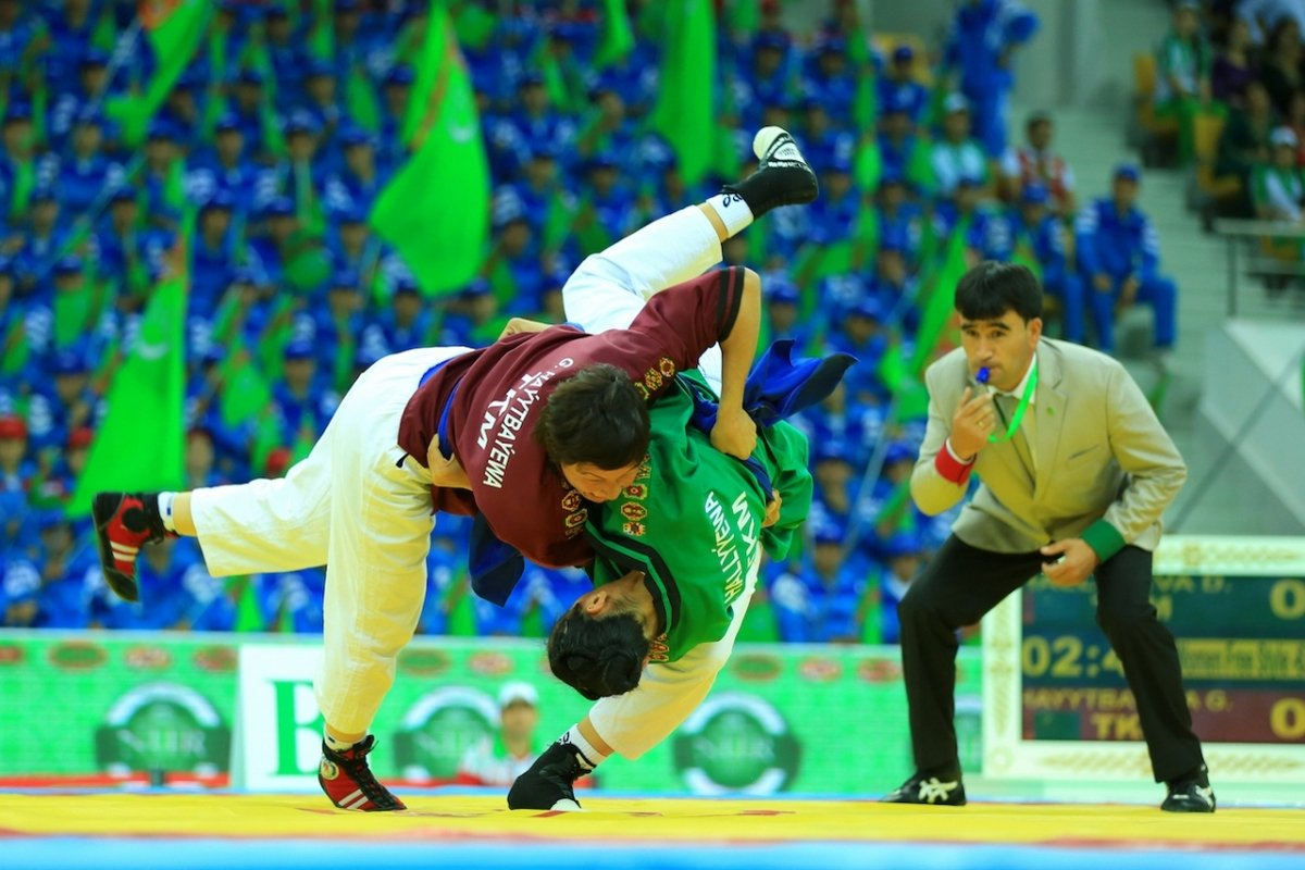 - Turkmen national wrestling with holding belts. A wrestler wins if manage to force the opponent to touch the ground with any part of the body except his feet three times. Reaps are allowed.