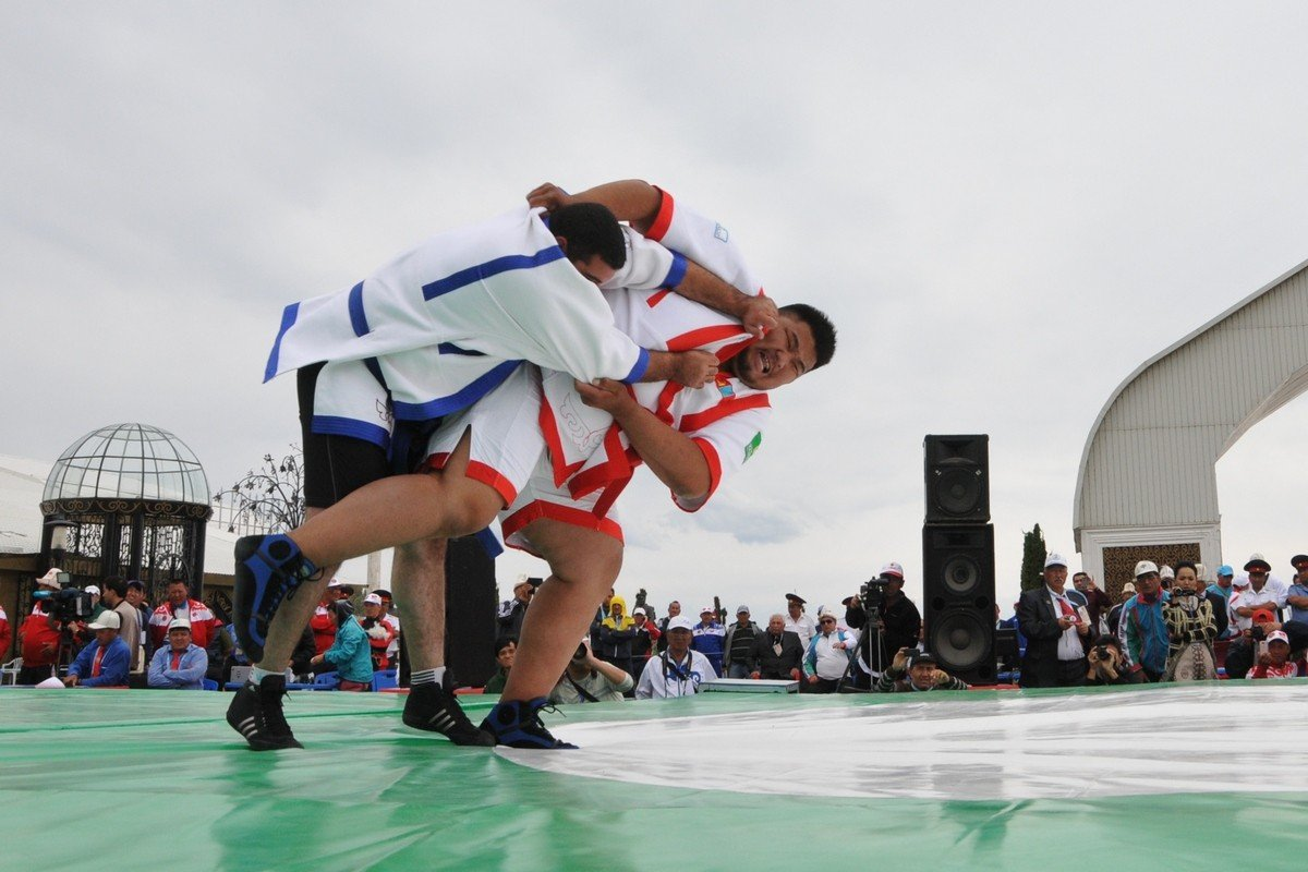 - One of the oldest Kazakh sports. Holding legs with arms is prohibited, everything above the waist are allowed. The goal is to to throw the opponent on his back.