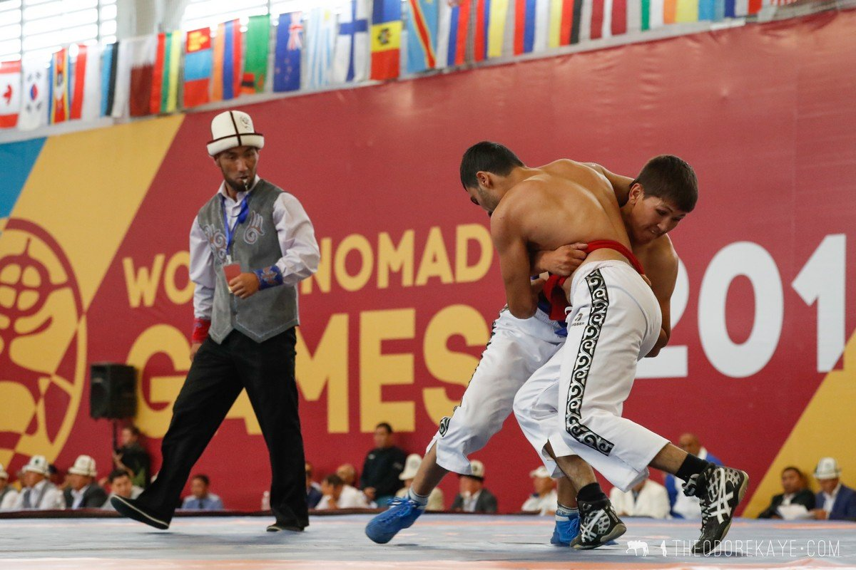 - Athletes stand opposite to each other on a special carpet and hold each others belts with both hands. The winner has to throw the opponent on his back.