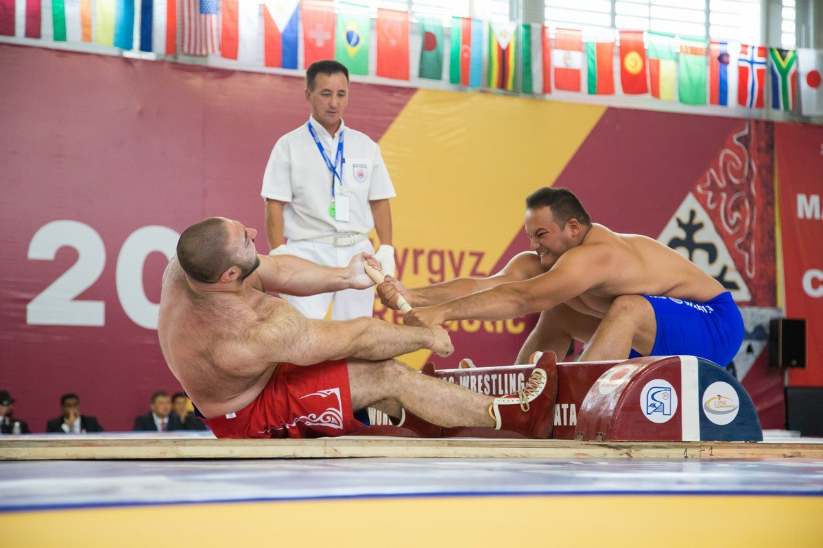 - In this Yakut national sport, opponents sit opposite to each other holding their feet againt the board and take the stick with both hands. To win one needs to pull out the stick from the hands of his opponent or to pull him over to one's side.