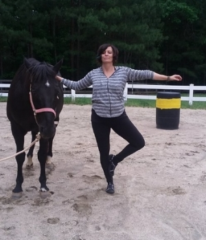 Me doing yoga with horses, courtesy of www.raleighncyoga.com 2017.