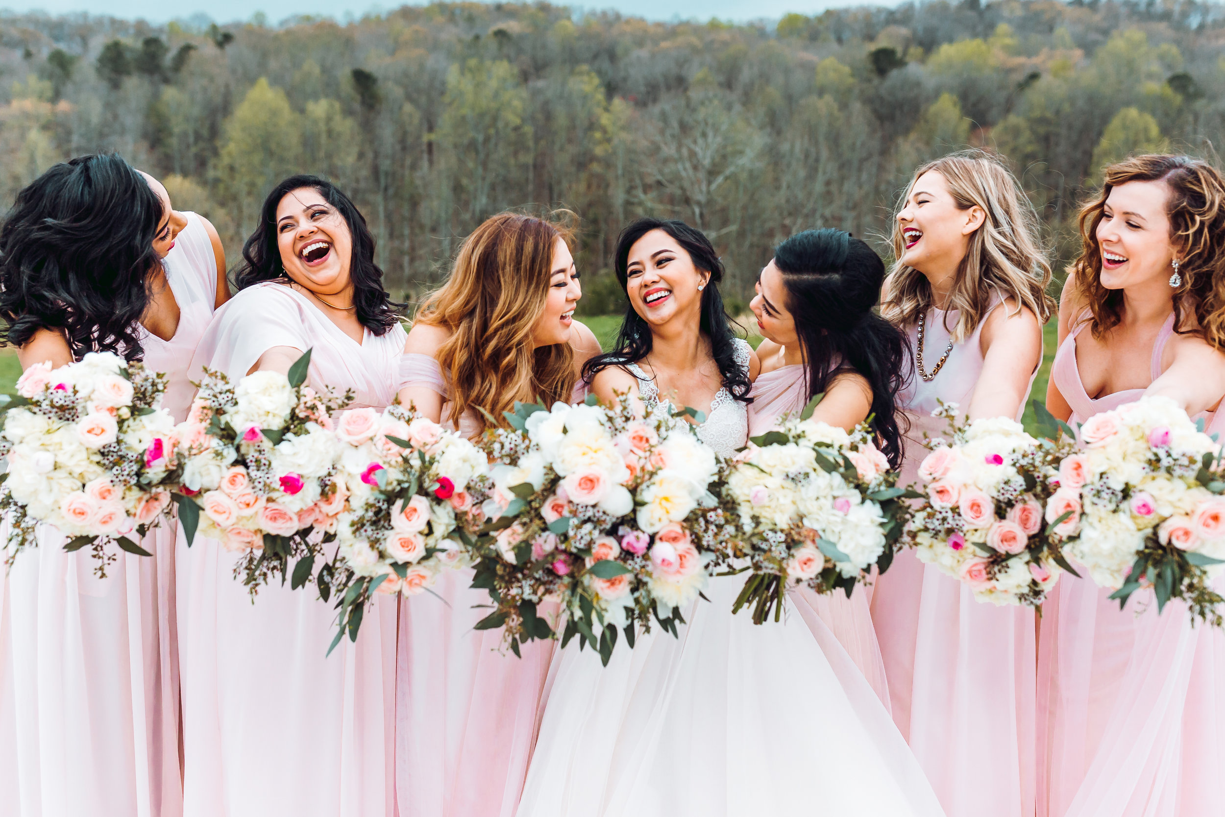 Your options are nearly endless during the Spring months because so many flowers are in season. These bouquets complement the chiffon dresses perfectly and consist of white hydrangea, pink spray roses, pink ranunculus and blush waxflower.